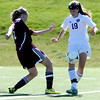 Holy Family's Daryl Mitzel (right) kicks the ball away from Berthoud's Lindsey Loberg (left) during their soccer game in Broomfield, Colorado May 8, 2012. BOULDER DAILY CAMERA/MARK LEFFINGWELL