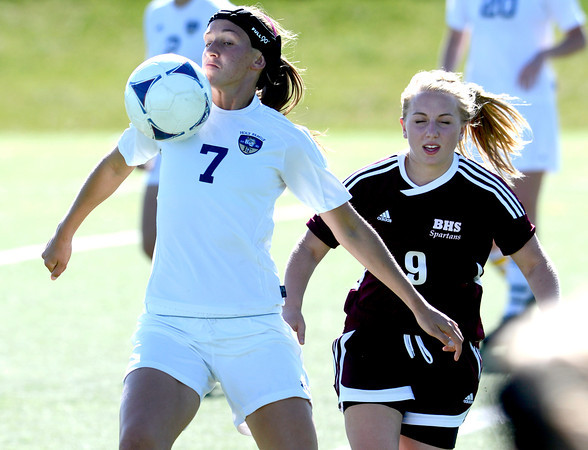 Holy Family's Ashley Burk (left) gains control of the ball while being pressured by Berthoud's Amy Taylor (right)go for the ball during their soccer gamein Broomfield, Colorado May 8, 2012. BOULDER DAILY CAMERA/MARK LEFFINGWELL