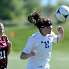 Holy Family's Kendall Russell (right) heads the ball away from Berthoud's Savanna Seat (left) during their soccer game in Broomfield, Colorado May 8, 2012. BOULDER DAILY CAMERA/MARK LEFFINGWELL