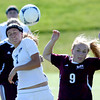 Berthoud's Amy Taylor (right) and  Holy Family's Ashley Burk (left) go for the ball during their soccer gamein Broomfield, Colorado May 8, 2012. BOULDER DAILY CAMERA/MARK LEFFINGWELL