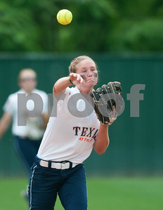 photo by Sarah A. Miller/Tyler Morning Telegraph   University of Texas at Tyler's Shelby Shelton throws the ball to first Friday during their game at UT Tyler's Suddenlink softball field.