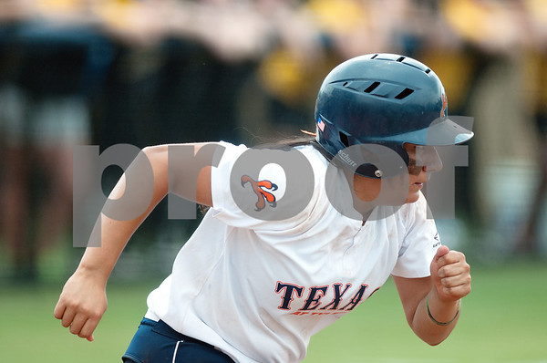 photo by Sarah A. Miller/Tyler Morning Telegraph  University of Texas at Tyler's Vanessa Carrizales runs to first base Friday during their game against Texas Lutheran University at UT Tyler's Suddenlink softball field.