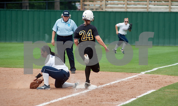 photo by Sarah A. Miller/Tyler Morning Telegraph  Texas Lutheran University's Ashley Jacobsen is out as University of Texas at Tyler's Jackie Mendez makes the catch at first base Friday during their game at UT Tyler's Suddenlink softball field.