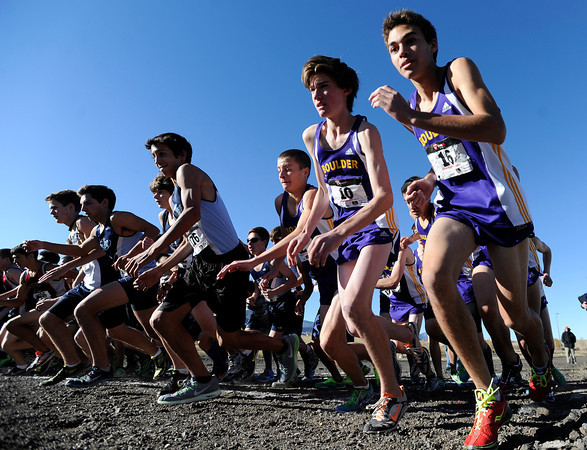 "Boulder High School's Dylan Moore, right, Satchel Caldwell and Kyle Lewis race out of the start during the varsity boys 5A Region 3 State Regionals at the North Area Athletic Complex in Arvada on Wednesday, Oct. 17. For more photos of the race go to  <a href=""http://www.dailycamera.com"">http://www.dailycamera.com</a>"