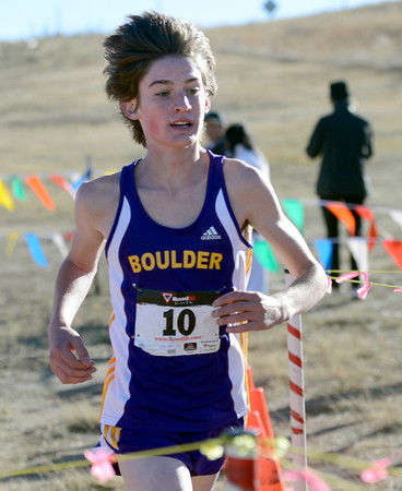"""Satchel Caldwell crosses the finish line in 6th during the varsity boys 5A Region 3 State Regional race at the North Area Athletic Complex in Arvada on Wednesday, Oct. 17. For more photos of the race go to  <a href=""""http://www.dailycamera.com"""">http://www.dailycamera.com</a>"""