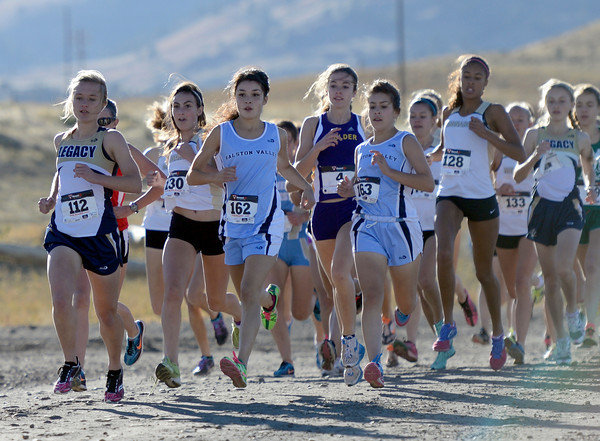 """Legacy High School senior Melanie Nun, left, leads the pack of varsity girls during the 5A Region 3 State Regionals at the North Area Athletic Complex in Arvada on Wednesday, Oct. 17. For more photos of the race go to  <a href=""""http://www.dailycamera.com"""">http://www.dailycamera.com</a>"""
