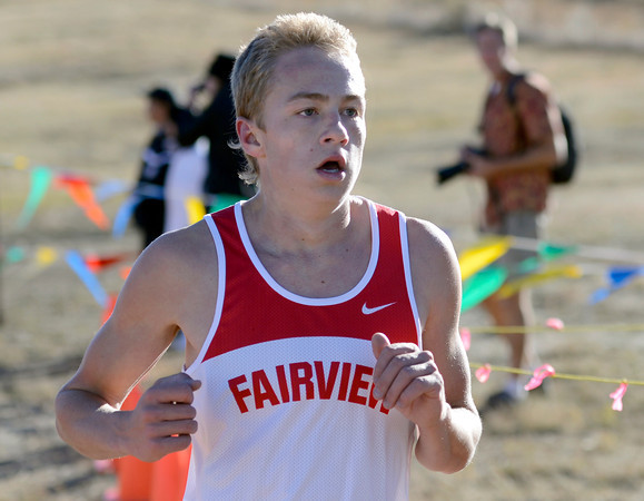 "Fairview High School senior Cory Munsch crosses the finish line in second-place during the varsity boys 5A Region 3 State Regional race at the North Area Athletic Complex in Arvada on Wednesday, Oct. 17. For more photos of the race go to  <a href=""http://www.dailycamera.com"">http://www.dailycamera.com</a>"