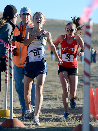 """Legacy High School's Emma Gee, left, crosses the finish line 2nd in front of Fairview High School's Isabelle Kennedy during the varsity girls 5A Region 3 State Regionals at the North Area Athletic Complex in Arvada on Wednesday, Oct. 17. For more photos of the race go to  <a href=""""http://www.dailycamera.com"""">http://www.dailycamera.com</a>"""