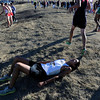 "Monarch High School's Kingston Wagner lays on the ground exhausted after finishing the varsity boys 5A Region 3 State Regionals at the North Area Athletic Complex in Arvada on Wednesday, Oct. 17. For more photos of the race go to  <a href=""http://www.dailycamera.com"">http://www.dailycamera.com</a>"