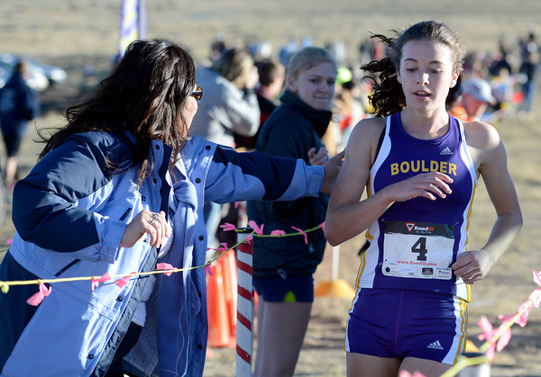 "Boulder High School junior Erin McLaughlin crosses the finish line 4th during the varsity girls 5A Region 3 State Regionals at the North Area Athletic Complex in Arvada on Wednesday, Oct. 17. For more photos of the race go to  <a href=""http://www.dailycamera.com"">http://www.dailycamera.com</a>"