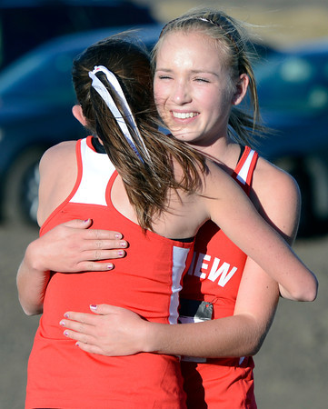 """Fairview High School's McKenna Payes, right, hugs teammate Isabelle Kennedy after finishing the varsity girls 5A Region 3 State Regionals at the North Area Athletic Complex in Arvada on Wednesday, Oct. 17. For more photos of the race go to  <a href=""""http://www.dailycamera.com"""">http://www.dailycamera.com</a>"""