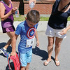 Ben Marchetti, 7, of Leominster gets some water poured on his head by his mom Jessica Marchetti after he finished the 5K road race to benefit the Boys & Girls Club of Fitchburg and Leominster on Saturday morning. SENTINEL & ENTERPRISE/JOHN LOVE