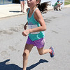 Nina Marchetti, 10, of Leominster finishes the 5K road race to benefit the Boys & Girls Club of Fitchburg and Leominster on Saturday morning. SENTINEL & ENTERPRISE/JOHN LOVE