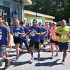 Runners talk off at the start of the 5K road race to benefit the Boys & Girls Club of Fitchburg and Leominster at the club on Saturday morning. /JOHN LOVE