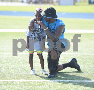 NFL player Teddy Williams talks to Nev'Aeh Moore, 8, during the Fast Like Teddy Speed and Agility Camp at John Tyler High School Saturday June 18, 2016. Williams is a John Tyler High School graduate.    (Sarah A. Miller/Tyler Morning Telegraph)
