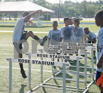 Children practice a drill at the Fast Like Teddy Speed and Agility Camp at John Tyler High School Saturday June 18, 2016. NFL player Teddy Williams hosted the camp.   (Sarah A. Miller/Tyler Morning Telegraph)