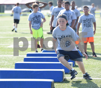 Travis Paul, 13, participates in a drill at the Fast Like Teddy Speed and Agility Camp at John Tyler High School Saturday June 18, 2016. NFL player Teddy Williams hosted the camp.   (Sarah A. Miller/Tyler Morning Telegraph)