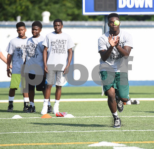 Kevin Bush, 16, runs a drill at the Fast Like Teddy Speed and Agility Camp at John Tyler High School Saturday June 18, 2016. NFL player Teddy Williams hosted the camp.   (Sarah A. Miller/Tyler Morning Telegraph)