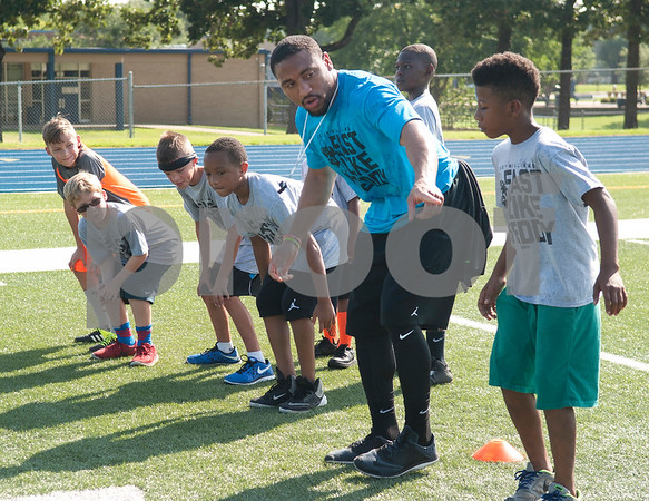 NFL player Josh Aubrey runs a drill with children at the Fast Like Teddy Speed and Agility Camp at John Tyler High School Saturday June 18, 2016. NFL player Teddy Williams hosted the camp.   (Sarah A. Miller/Tyler Morning Telegraph)