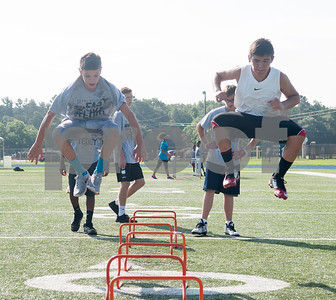 Caleb Carpenter and Christian Herrera jump during the Fast Like Teddy Speed and Agility Camp at John Tyler High School Saturday June 18, 2016. Teddy Williams is an NFL player and a John Tyler High School graduate.    (Sarah A. Miller/Tyler Morning Telegraph)