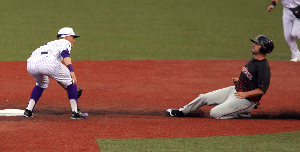 . Crushers shortstop Max Casper makes an easy tag on Washington\'s Justin Bohn as he slides into second base. Randy Meyers -- The Morning Journal