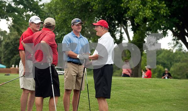 photo by Sarah A. Miller/Tyler Morning Telegraph  Ken Talkington of Arlington, Jimmy Wester of Tyler, Bart Talkington of Flower Mound and Joe McMahan of Tyler wait to tee during the Texas Tech J. L. Gulley, Jr. Annual Tyler Golf Tournament held at Willow Brook Country Club in Tyler Monday. The event raises scholarship funds for students.