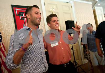 photo by Sarah A. Miller/Tyler Morning Telegraph  Kliff Kingsbury, head coach of the Texas Tech Red Raiders football program, takes a photo with Lindale High School senior David Slice after the luncheon during the Texas Tech J. L. Gulley, Jr. Annual Tyler Golf Tournament held at Willow Brook Country Club in Tyler Monday. The event raises scholarship funds for students. Slice is a recipient of the J.L. Gulley, Jr. Texas Tech Scholarship and will attend school this fall.