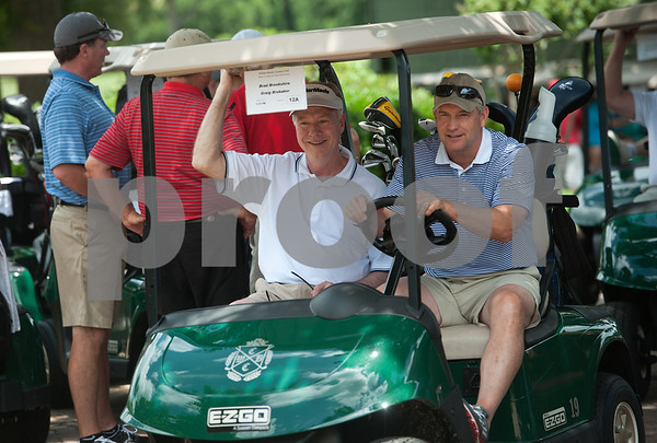 photo by Sarah A. Miller/Tyler Morning Telegraph  Craig Brubaker and Brad Brookshire drive off to the course to start the Texas Tech J. L. Gulley, Jr. Annual Tyler Golf Tournament held at Willow Brook Country Club in Tyler Monday. The event raises scholarship funds for students.