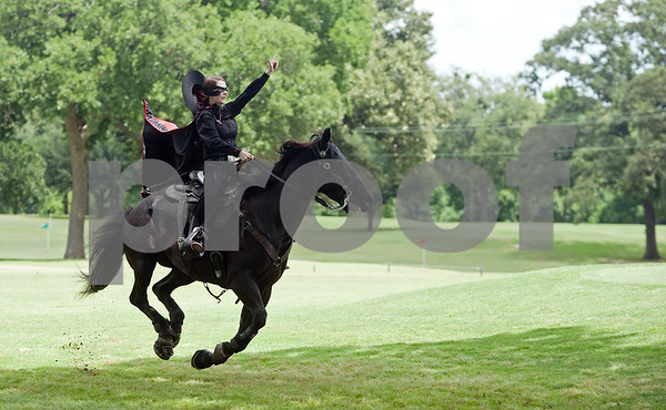 photo by Sarah A. Miller/Tyler Morning Telegraph  Texas Tech Masked Rider Mackenzie White rides down the fairway on Fearless Champion during the Texas Tech J. L. Gulley, Jr. Annual Tyler Golf Tournament held at Willow Brook Country Club in Tyler Monday. The event raises scholarship funds for students.