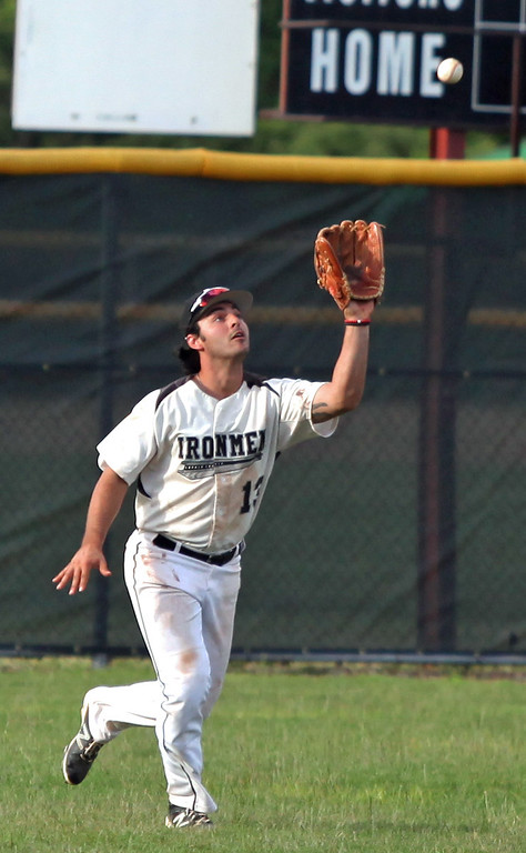 . Ironmen outfielder Sam Casinelli tracks down a deep fly ball. Randy Meyers -- The Morning Journal