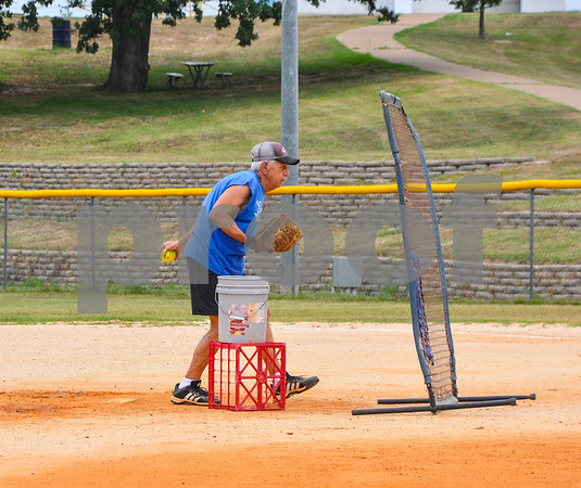 Larry Brown, 71, of the Tyler Senior Softball League throws a pitch during practice at Lindsey Park on Sunday, June 3. (Jessica T. Payne/Tyler Paper)