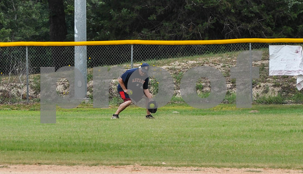 Outfielder Benny Mott, 58, goes low for a ground ball during a Tyler Senior Softball League practice at Lindsey Park on Sunday, June 3. (Jessica T. Payne/Tyler Paper)