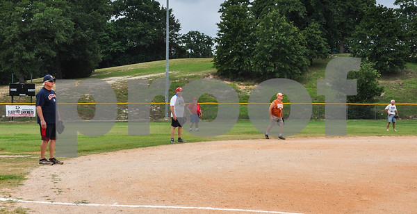 Outfielders in the Tyler Senior Softball League get ready for the next batter during a league practice at Lindsey Park on Sunday, June 3. (Jessica T. Payne/Tyler Paper)