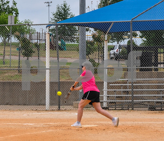 Patricia Johnson, 67, connects with a pitch at a Tyler Senior Softball League practice on Sunday, June 3. Johnson is one of three women who plays in the league. (Jessica T. Payne/Tyler Paper)
