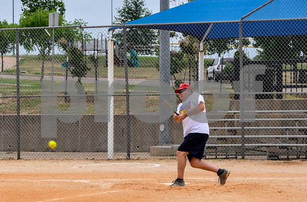 Bob Strong, 75, who heads up the Tyler Senior Softball League, hits a pitch at practice on Sunday, June 3. The league is preparing to start their season later this month. (Jessica T. Payne/Tyler Paper)