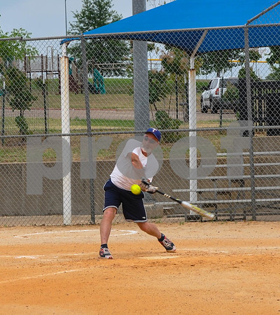 Duane Nash, 63, goes low to connect with a pitch during a Tyler Senior Softball League practice on Sunday, June 3. The league, which consists of 5 teams of different age groups, practices at Lindsey Park in Tyler and is preparing for their first game. (Jessica T. Payne/Tyler Paper)