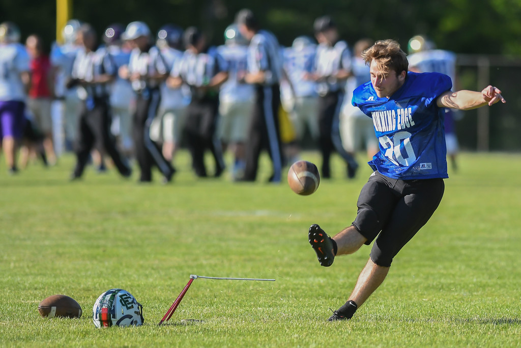 . Elyria Catholic\'s Tanner Brooks warms up prior to the start of the Winning Edge All-Star game. Eric Bonzar � The Morning Journal