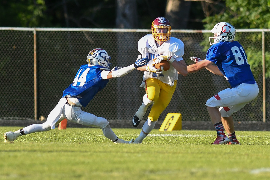 . Avon Lake\'s Mike Davis (11) breaks two tackles from Clearview\'s Jacob Collier (44) and Firelands\' Collin Myers (81) during the second quarter. Eric Bonzar � The Morning Journal