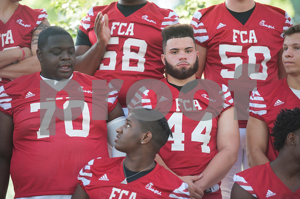 Members of the football teams wait for a group photo at the Northeast Texas Fellowship of Christian Athletes Heart of a Champion All-Star Media Day Thursday June 9, 2016 at Tyler Junior College. The Heart of a Champion Bowl will kick off at 6:30 p.m. Saturday at Trinity Mother Frances Rose Stadium.  (Sarah A. Miller/Tyler Morning Telegraph)