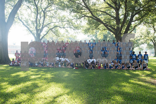 The two football teams take a group photo at the Northeast Texas Fellowship of Christian Athletes Heart of a Champion All-Star Media Day Thursday June 9, 2016 at Tyler Junior College. The Heart of a Champion Bowl will kick off at 6:30 p.m. Saturday at Trinity Mother Frances Rose Stadium.  (Sarah A. Miller/Tyler Morning Telegraph)