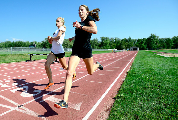 "Olympic hopefuls Emma Coburn (left) and Shalaya Kipp (right) workout at Pott's Field in Boulder, Colorado July 10, 2012.  DAILY CAMERA MARK LEFFINGWELL<br /> <br /> See video of their workout at  <a href=""http://www.dailycamera.com"">http://www.dailycamera.com</a>"