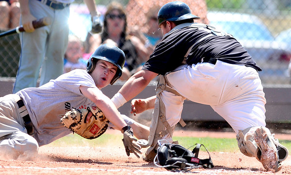 Erie/Longmont's Tyler Lee is tagged out at home by Onefifteen's catcher Connor Osgood during their game in Lafayette, Colorado July 11, 2012.  DAILY CAMERA MARK LEFFINGWELL
