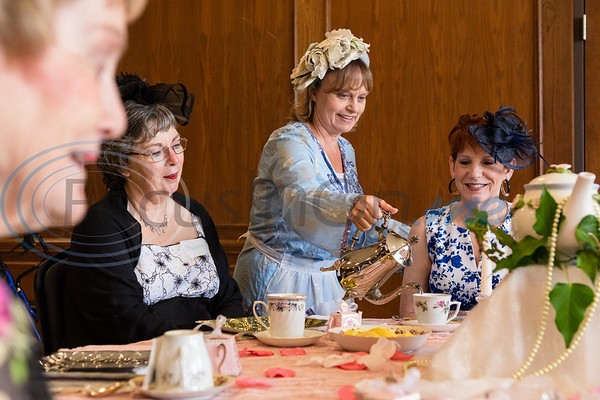 """Brenda Hammond (left) looks on as Memori Ruesing, portraying an Irish tea lady named Katie Poppins, serves hot water to Regina Money during a """"Ribbons, Roses and Lace"""" themed Victorian tea, kicking off the Ms. Texas Senior Classic Pageant season, Friday morning in the Rose Room at the Tyler Rose Garden Center in Tyler.  (Cara Campbell/Tyler Morning Telegraph)"""