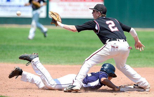 Manhattan's Jonah Webber (left) beats the throw to Fairview's Jeremy Katz (right) during their game in Boulder, Colorado July 13, 2012.  DAILY CAMERA MARK LEFFINGWELL