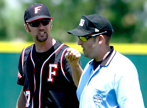 Fairview coach Sean Costello (left) yells at the umpire after getting ejected from the game over a disagreement on a call in Boulder, Colorado July 13, 2012.  DAILY CAMERA MARK LEFFINGWELL