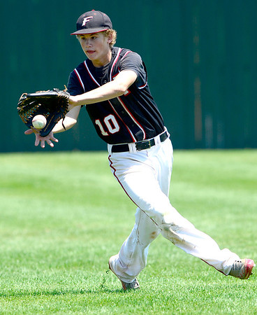 Fairview's Johnny Feauto grabs a line drive during their game in Boulder, Colorado July 13, 2012.  DAILY CAMERA MARK LEFFINGWELL