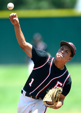 Fairview's Tim Ryan pitches against Manhattan during their game in Boulder, Colorado July 13, 2012.  DAILY CAMERA MARK LEFFINGWELL