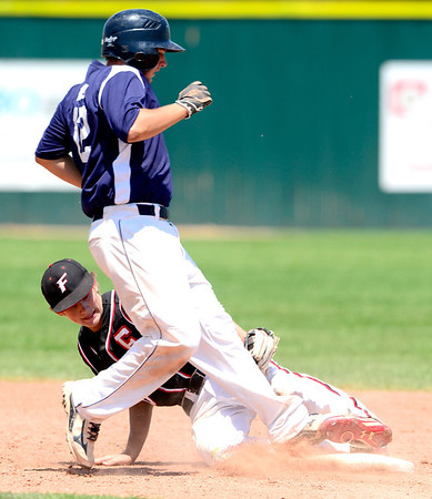 Fairview's Johnny Feauto (back) tags out Manhattan's Tyler Holen (right) at 2nd during their game in Boulder, Colorado July 13, 2012.  DAILY CAMERA MARK LEFFINGWELL
