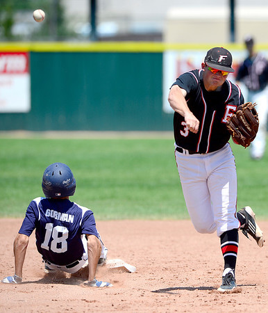 Fairview's Cam Fraizer (right) makes the throw to 1st for a double play after tagging out Manhattan's Caleb Gorman (left) during their game in Boulder, Colorado July 13, 2012.  DAILY CAMERA MARK LEFFINGWELL