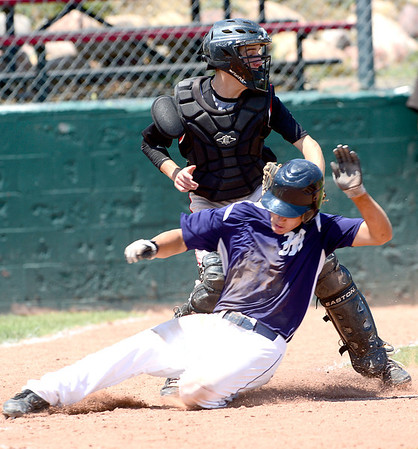 Fairview'sCannon Casey (back) tags Manhattan's Jonah Webber (front)out at home during their game in Boulder, Colorado July 13, 2012.  DAILY CAMERA MARK LEFFINGWELL